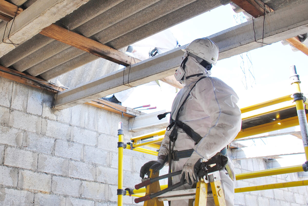 Asbestos Waste Removal - Worker in personal protective equipment