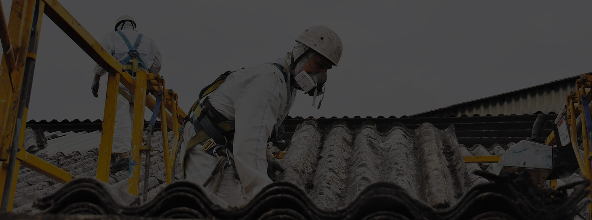 Asbestos Waste Collection - Workers on roof collecting asbestos