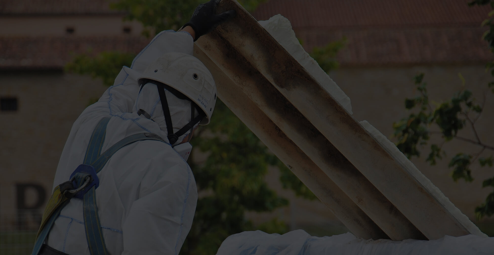 Asbestos Waste Removal - The worker leaves the asbestos waste