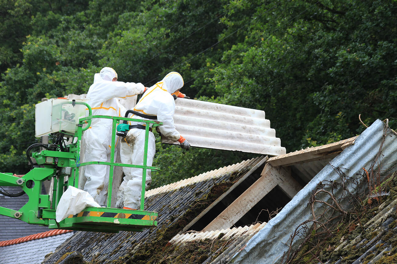 Asbestos Removal Service - Workers remove asbestos from roof