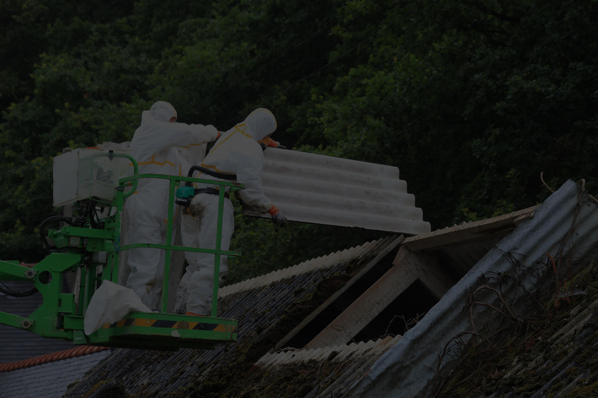 Licensed Asbestos Removal - Workers remove asbestos from roof