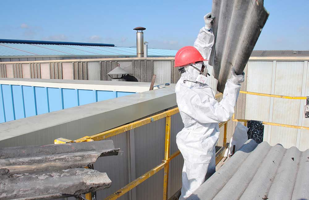 Piling Asbestos on Commercial Building